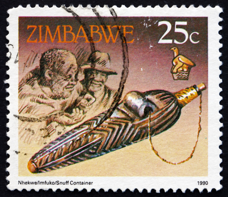 tabaco: ZIMBABWE - alrededor de 1990: un sello impreso en Zimbabwe muestra Tabaco caja, alrededor de 1990