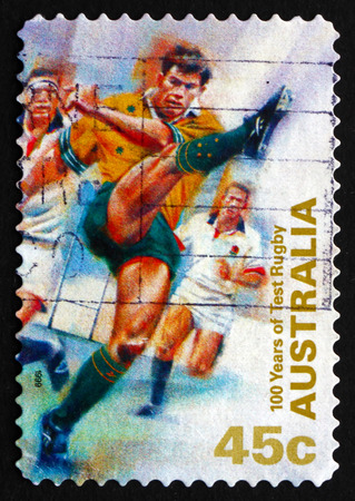 AUSTRALIA - CIRCA 1999: a stamp printed in the Australia shows Kicking Ball, Test Rugby in Australia, Centenary, circa 1999