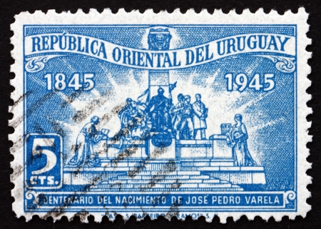sociologist: URUGUAY - CIRCA 1945: a stamp printed in the Uruguay shows Monument to Jose Pedro Varela, Author, circa 1945 Editorial