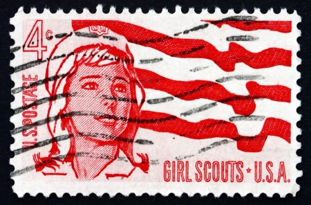 girl scout: UNITED STATES OF AMERICA - CIRCA 1962: a stamp printed in the USA shows Senior Girl Scout and Flag, Girl Scout of America, 50th Anniversary, circa 1962