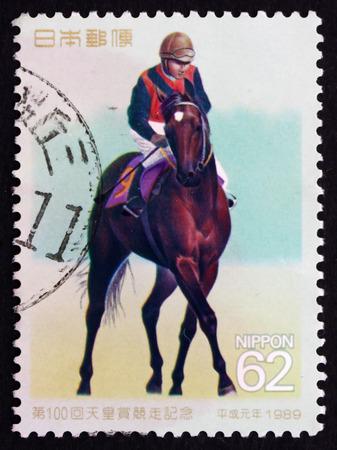 sho: JAPAN - CIRCA 1989: a stamp printed in the Japan shows Jockey Riding Shinzan, 100th Tenno Sho Horse Race, circa 1989 Editorial