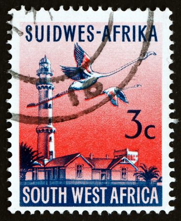 SOUTH WEST AFRICA - CIRCA 1962: a stamp printed in South West Africa shows Swakopmund Lighthouse and Flamingoes, circa 1962