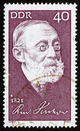 anthropologist: GDR - CIRCA 1971: a stamp printed in GDR shows Rudolf Carl Virchow, Doctor, Anthropologist, Pathologist and Politician, Known for His Advancement of Public Health, circa 1971