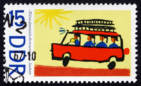 antique fire truck: GDR - CIRCA 1967: a stamp printed in GDR shows Fire Truck, Children's Drawing, circa 1967