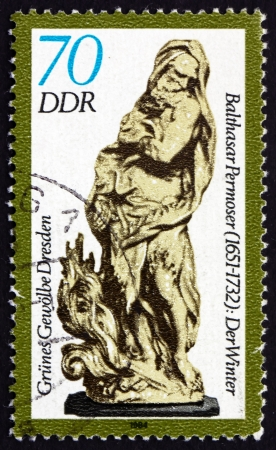 balthasar: GDR - CIRCA 1984: a stamp printed in GDR shows Winter, Figurine by Balthasar Permoser, Green Vault of Dresden, circa 1984