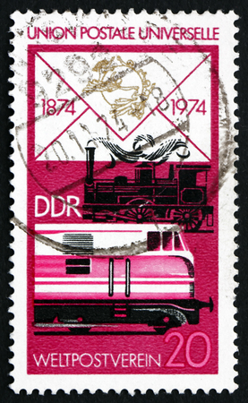 upu: GDR - CIRCA 1974: a stamp printed in GDR shows Old Steam Locomotive and Modern Diesel, Centenary of the UPU, circa 1974
