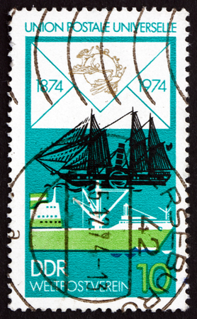 upu: GDR - CIRCA 1974: a stamp printed in GDR shows Freighter and Paddle Steamer, Centenary of the UPU, circa 1974