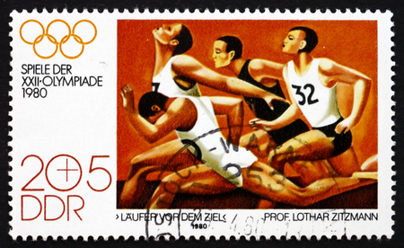 summer olympics: GDR - CIRCA 1980: a stamp printed in GDR shows Runners at the Finish, by Lothar Zitzmann, Summer Olympics 1980, Moscow, circa 1980