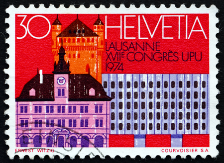 upu: SWITZERLAND - CIRCA 1974: a stamp printed in the Switzerland shows Old Houses, Parliament and RR Station, Bern, Centenary of the UPU, circa 1974