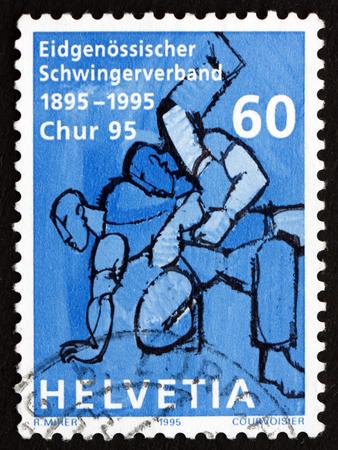 SWITZERLAND - CIRCA 1995: a stamp printed in the Switzerland shows Wrestler, Centenary of Swiss Wrestling Association, circa 1995