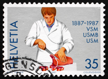 helvetia: SWITZERLAND - CIRCA 1987: a stamp printed in the Switzerland shows Butcher, Centenary of Swiss Master Butchers Federation, circa 1987 Editorial