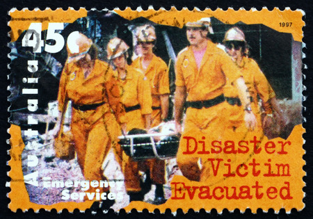 rescuing: AUSTRALIA - CIRCA 1997: a stamp printed in the Australia shows Disaster Victim Evacuated, circa 1997