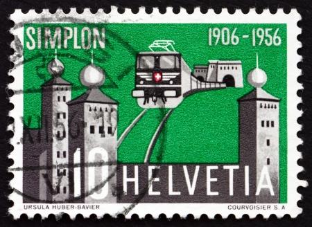 north gate: SWITZERLAND - CIRCA 1956: a stamp printed in the Switzerland shows North Gate of Simplon Tunnel and Stockalper Palace, Train, circa 1956