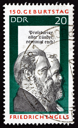 marx: GDR - CIRCA 1970: a stamp printed in GDR shows Friedrich Engels and Karl Marx, Social Scientist, Political Theorist and Marxist, circa 1970