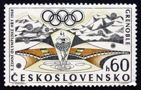CZECHOSLOVAKIA - CIRCA 1968: a stamp printed in the Czechoslovakia shows Figure Skating and Olympic Rings, 10th Winter Olympic Games, Grenoble, France, circa 1968