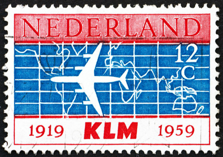NETHERLANDS - CIRCA 1959: a stamp printed in the Netherlands shows Douglas DC-8 and World Map, 40th Anniversary of the Founding of KLM, Royal Dutch Airlines, circa 1959