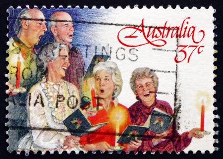 AUSTRALIA - CIRCA 1987: a stamp printed in the Australia shows Three Women and Two Men, Carolers, Christmas, circa 1987