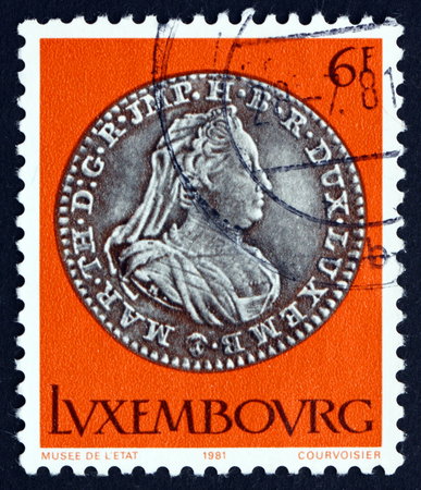 LUXEMBOURG - CIRCA 1981: a stamp printed in the Luxembourg shows Empress Maria Theresa  12 Sol, 1775, Silver Coin, circa 1981