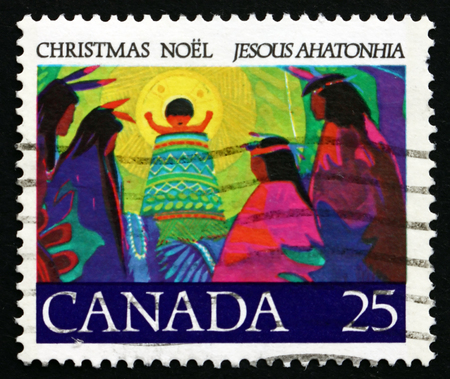 chiefs: CANADA - CIRCA 1977: a stamp printed in the Canada shows Christ Child in Ring of Glory Blessing Chiefs from Afar, Illustration for Canada�s first Christmas Carol, by Father Brebeuf, circa 1977 Editorial