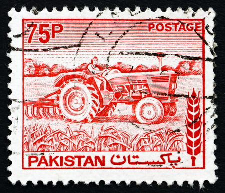 PAKISTAN - CIRCA 1978: a stamp printed in Pakistan shows Woman Tractor Driver, circa 1978 Stock Photo - 25124858