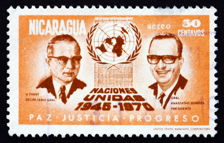un used: NICARAGUA - CIRCA 1972: a stamp printed in Nicaragua shows U Thant, Anastasio Somoza, UN Emblem, 25th Anniversary of the United Nations, circa 1972 Editorial