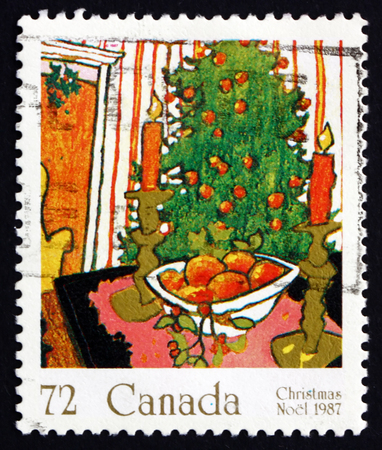 CANADA - CIRCA 1987: a stamp printed in the Canada shows Mistletoe and Christmas tree, Christmas, circa 1987