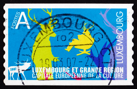 LUXEMBOURG - CIRCA 2006: a stamp printed in the Luxembourg shows Silhouettes of Deer and Men with Deer Heads, circa 2006