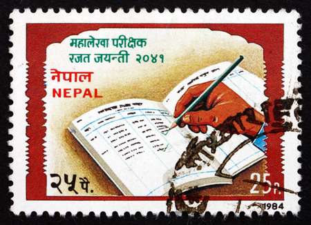 ledger: NEPAL - CIRCA 1984: a stamp printed in the Nepal shows Open Ledger, Auditor General, 25th Anniversary, circa 1984