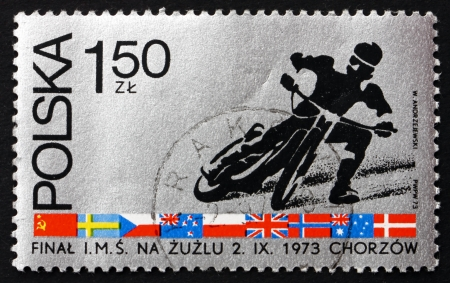 finals: POLAND - CIRCA 1973: a stamp printed in the Poland shows Motorcyclist, Finals in Individual World Championship Motorcycle Race on Cinder Track, Chorzow, circa 1973 Editorial