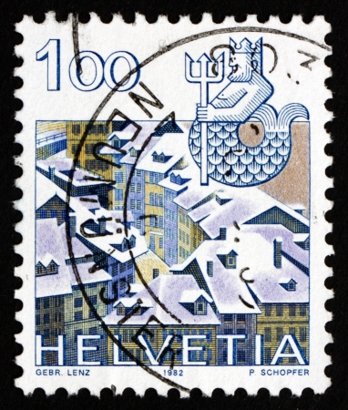 SWITZERLAND - CIRCA 1982: a stamp printed in the Switzerland shows Aquarius, Old Bern, Sign of the Zodiac and City View, circa 1982