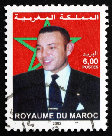 mohammed: MOROCCO - CIRCA 2002: a stamp printed in Morocco shows Mohammed VI, King of Morocco, circa 2002 Editorial