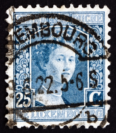reign: LUXEMBOURG - CIRCA 1914: a stamp printed in the Luxembourg shows Marie Adelaide, Grand Duchess of Luxembourg, Reign from 1912 to 1919, circa 1914