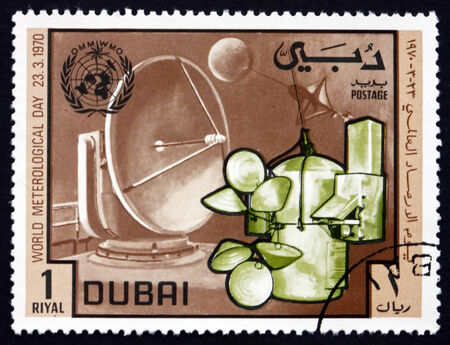 meteorological: DUBAI - CIRCA 1970: a stamp printed in the Dubai shows Kew-type Radio Sonde, Weather Ballon and Radar Antenna, 10th World Meteorological Day, circa 1970