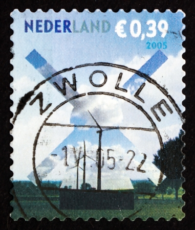 NETHERLANDS - CIRCA 2005: a stamp printed in the Netherlands shows Windmill and Field, Building Silhouettes, circa 2005