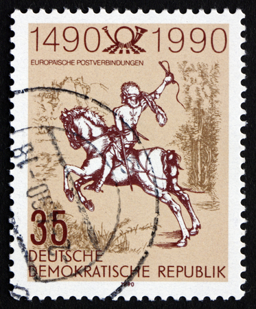 durer: GDR - CIRCA 1990: a stamp printed in GDR shows The Young Post Rider, an Engraving by Albrecht Durer, circa 1990 Editorial