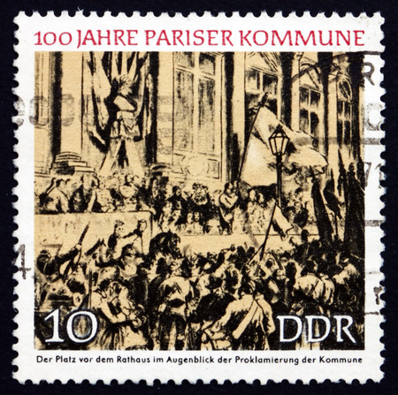 proclamation: GDR - CIRCA 1971: a stamp printed in GDR shows Proclamation of the Commune, Town Hall, Paris, Centenary of the Paris Commune, circa 1971