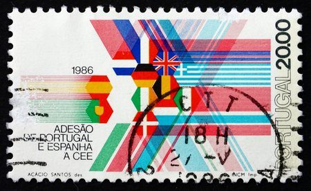 european economic community: PORTUGAL - CIRCA 1986: a stamp printed in the Portugal shows Flags of EEC Member Nations, Admission of Portugal and Spain to the EEC, circa 1986