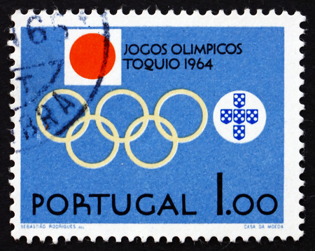 olympic symbol: PORTUGAL - CIRCA 1964: a stamp printed in the Portugal shows Olympic Rings, Emblems of Portugal and Japan, 18th Olympic Games, Tokyo, circa 1964