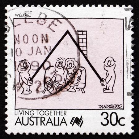 public welfare: AUSTRALIA - CIRCA 1988: a stamp printed in the Australia shows Welfare, Living Together, circa 1988