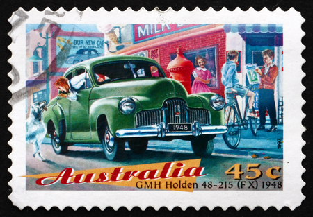 fx: AUSTRALIA - CIRCA 1997: a stamp printed in the Australia shows GMH Holden 48-215 (FX), Classic Car from 1948, circa 1997 Editorial