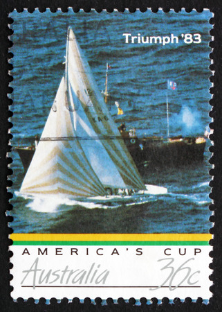 AUSTRALIA - CIRCA 1986: a stamp printed in the Australia shows Australia II Crossing Finish Line, Americas Cup Triumph 83, circa 1986