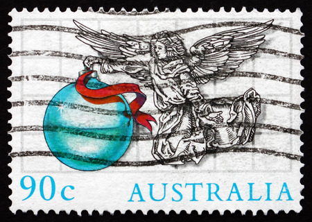 AUSTRALIA - CIRCA 1985: a stamp printed in the Australia shows Angel with Ornament, Illustration by Scott Hartshorne, Christmas, circa 1985