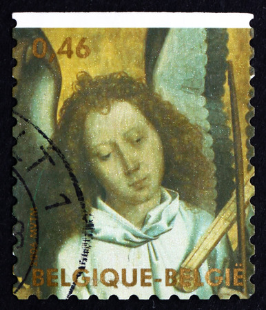 memling: BELGIUM - CIRCA 2006: a stamp printed in the Belgium shows Head of Angel Playing Trumpet Marine, Angel Painted by Hans Memling, Christmas, circa 2006