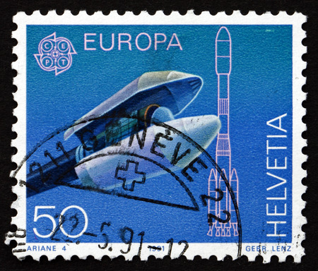 payload: SWITZERLAND - CIRCA 1991: a stamp printed in the Switzerland shows Ariane Payload Fairing, Nose Cone Used to Protect a Spacecraft, circa 1991