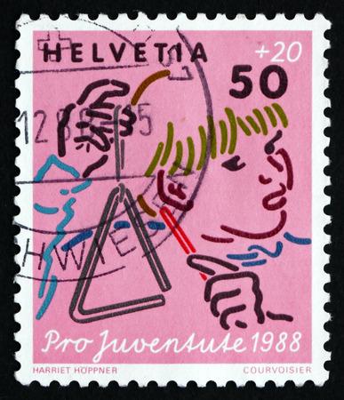 helvetia: SWITZERLAND - CIRCA 1988: a stamp printed in the Switzerland shows Music, Child Development, circa 1988