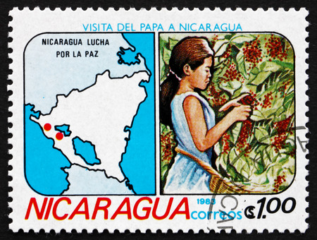 NICARAGUA - CIRCA 1983: a stamp printed in Nicaragua shows Girl Picking Coffee Beans and Map, Visit of Pope John Paul II, circa 1983