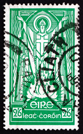 paschal: IRELAND - CIRCA 1943: a stamp printed in the Ireland shows St. Patrick and Paschal Fire, circa 1943 Editorial