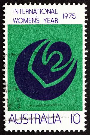 womanhood: AUSTRALIA - CIRCA 1975: a stamp printed in the Australia shows Symbols of Womanhood, Sun, Moon, International Women�s Year, circa 1975