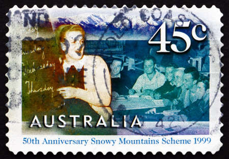 migrant: AUSTRALIA - CIRCA 1999: a stamp printed in the Australia shows English Class for Migrant Workers at Cooma, 50th Anniversary of the Snowy Mountains Scheme, circa 1999