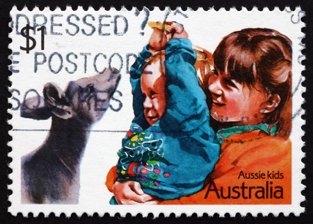 AUSTRALIA - CIRCA 1987: a stamp printed in the Australia shows Playing with a Joey, Children, circa 1987